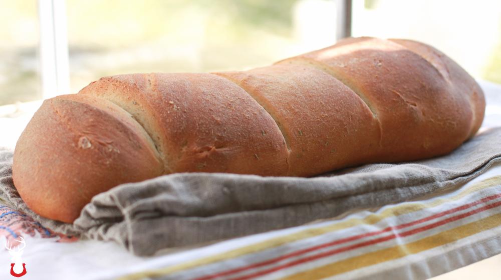 Fresh loaf of G@H's Honey Rosemary Bread