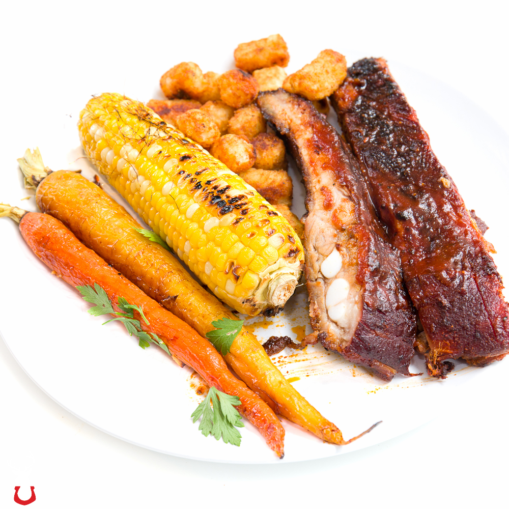 Smoked pork spare ribs, grilled corn and roasted carrots